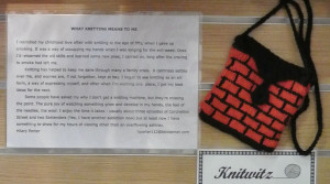 Hilary Porter's black and red brick pattern knitted handbag and the note