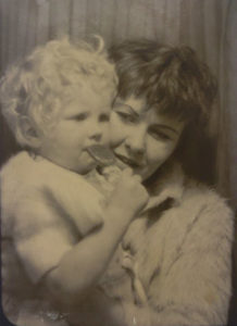 Old photoboot picture of Shirley McNamara holding baby Julie in her arms