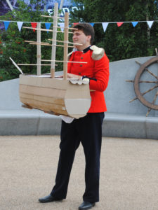 Admiral Pullen holds his handmade wooden boat. Photo credit: Emilia Teglia