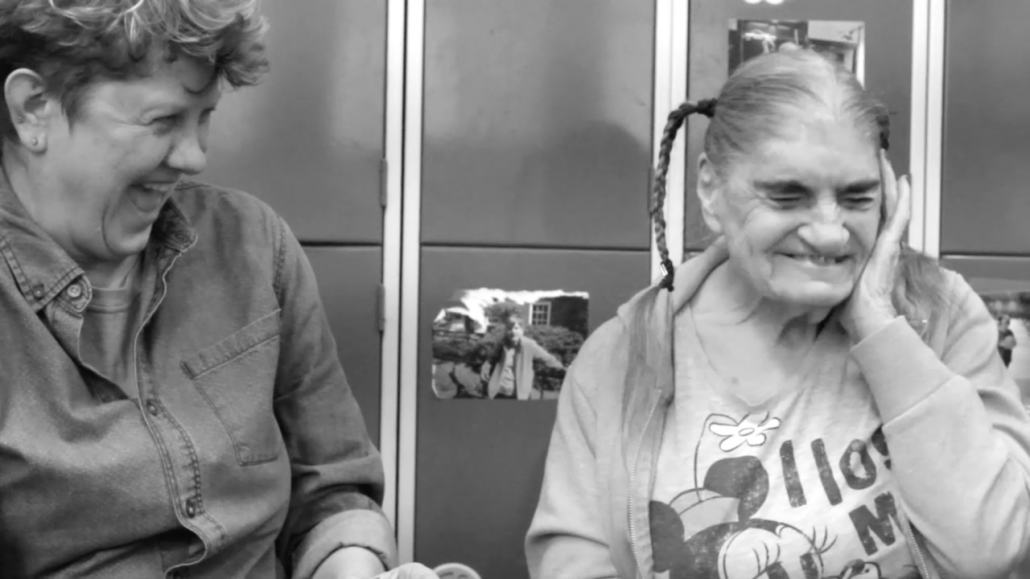 Julie Mc with Betty Mills, member of the original Knitting Circle 1983, screenshot by Zeynep Dagli from the award winning documentary: Voices From The Knitting Circle directed by Julie McNamara, edited by Zeynep Dagli with additional editing by Lesley Willis.