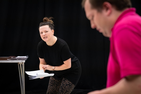 Female actor Lisette Auton (left) rehearsing the character of Mad Mary, with male actor Eden West looking down at his script.